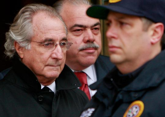Bernard Madoff leaves federal court on Jan. 14. He is currently confined to his Manhattan penthouse under arrest, accused of bilking investors of $50 billion.