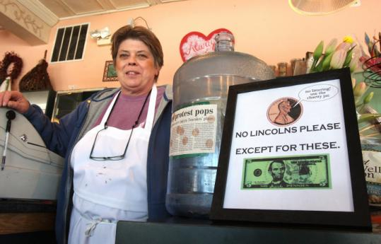 Judy Fersh of Concord Teacakes and other merchants plan to avoid pennies by rounding down transactions to the nickel.