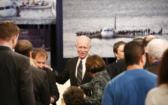 Chesley Sullenberger (center) and the crew talked to passengers during an appearance on CBS's ''The Early Show'' yesterday.
