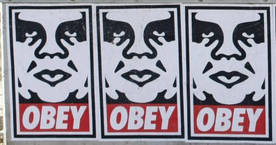 Shepard Fairey's work is on display on a building near the Massachusetts Turnpike at Mass. Ave. and Newbury Street.