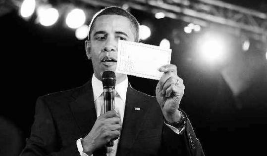 President Obama read a note handed to him during a town hall-style meeting yesterday in Fort Myers, Fla., that said the Senate had just approved the $838 billion stimulus plan.