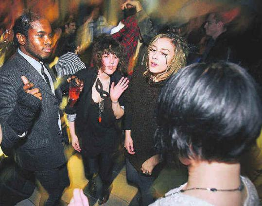 Susan Gertner (center), a.k.a. Susie G., dances at a party at Privus Lounge in Allston.