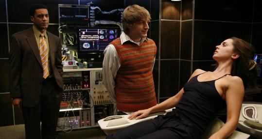 Eliza Dushku stars with Fran Kranz (center) and Harry Lennix in the new sci-fi series ''Dollhouse.''