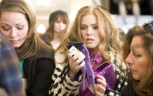 Isla Fisher (center) stars as a young woman battling to curtail an addiction to spending money on fashions in ''Confessions of a Shopaholic.''