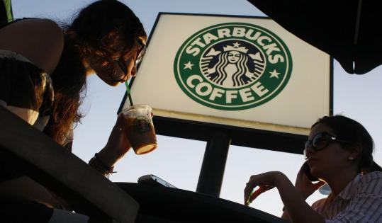 Starbucks has said it might lay off as many as 6,700 employees this year and plans to close 300 stores in a cost-cutting effort.