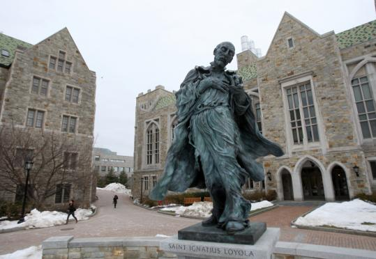 The recently added statue near Higgins Hall depicting St. Ignatius Loyola, founder of the Jesuit order that runs Boston College, reflects the university's campuswide effort to reclaim its Catholic identity.