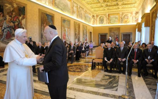 Pope Benedict XVI shook hands with the head of the American Jewish congress, Rabbi Marc Schneier, yesterday at the Vatican.