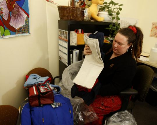 Alison Bromley, a social worker at Travelers Aid, sifts through clothes donations: ''One unexpected expense - an emergency room co-pay, for example - can throw you right off track.''