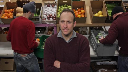 Boston Organics founder Jeff Barry at his warehouse in Charlestown, where orders are filled. A box of seasonal root vegetables costs $29 and is sourced as close to Boston as possible.