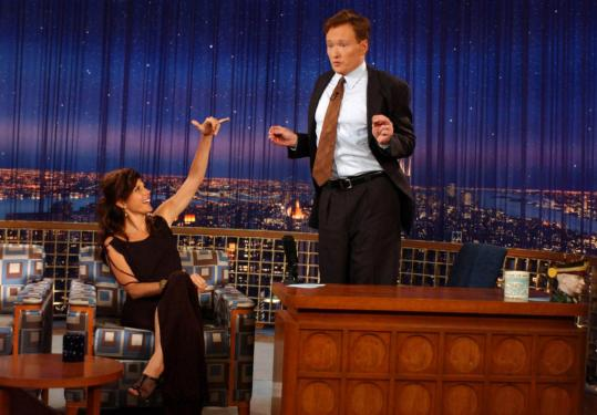 Late-night talk-show host Conan O'Brien breaks into his ''string dance'' for guest Marisa Tomei.