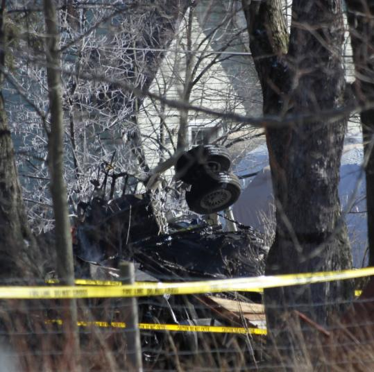 The wreckage of Continental Connection Flight 3407 was seen where it crashed into a house in Clarence, N.Y., Thursday. Officials have not determined the cause of the crash.