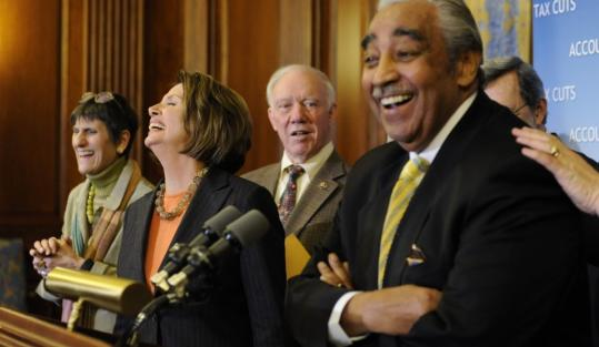 House Speaker Nancy Pelosi (second from left) celebrated with Representatives Rosa DeLauro, James Oberstar, and Charles Rangel yesterday during a news conference after House passage of the stimulus legislation.