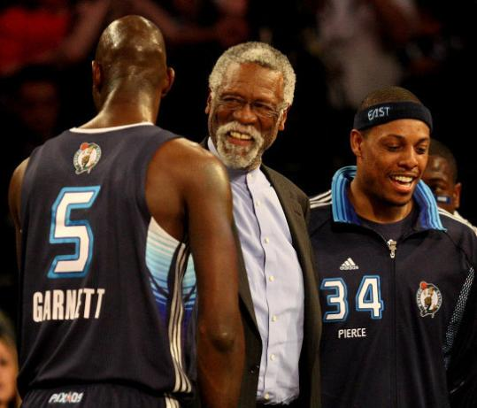 Current Celtic stars Kevin Garnett and Paul Pierce greet Celtic legend Bill Russell.