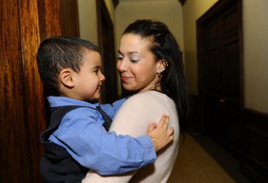 ''It's a catch-22,'' Grace Monteiro, with her son Keegan, said of housing regulations for the city's homeless. Monteiro, 28, has been in and out of shelters and apartments for several years.