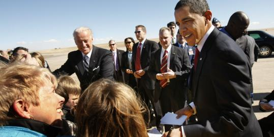 President Obama and Vice President Joe Biden greeted visitors yesterday after arriving at Buckley Air Force Base in Colorado.