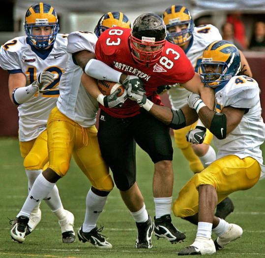 Prepping for the NFL Combine was no drag for Northeastern's Brian Mandeville, nor was this run vs. Delaware.