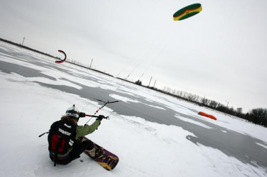 One of a new breed of plainsmen, a snow kiter relishes the wind sweeping him across Devils Lake in North Dakota.