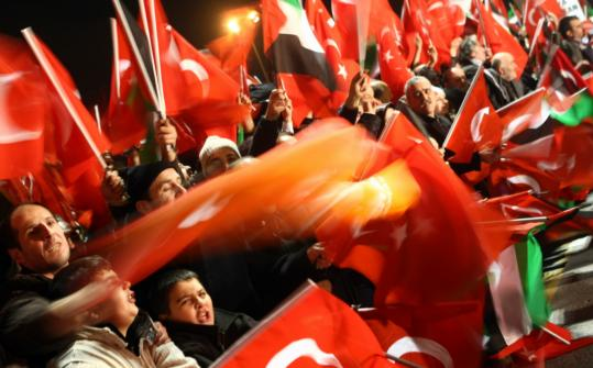 Supporters of the Justice and Developpment Party (AKP) waved national and Palestinian flags as Turkish Prime Minister Recep Tayyip Erdogan arrived at the airport in Instanbul last month.