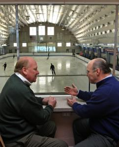 NESC's Wes Tuttle (left) visits with Skating Club of Boston board member Tobey Choate.