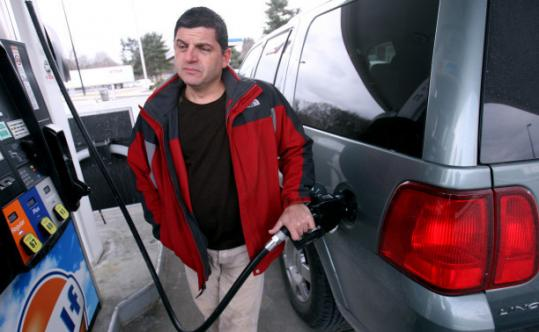 Bill Greene/Globe StaffJoe Ciaramitaro of Gloucester calculated that the tax plan could cost him an extra $5 when filling up.