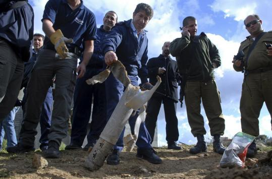 An Israeli police officer investigated the remains of a rocket yesterday. One of two rockets fired hit a mostly Christian Arab village in northern Israel, slightly injuring one person.