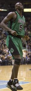 A painful sight for the Celtics: Kevin Garnett hurts his knee against the Jazz Thursday.