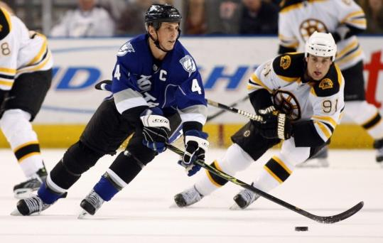 The Lightning's Vincent Lecavalier has a step on the Bruins' Marc Savard in the second period.