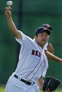 Sox reliever Takashi Saito gets in some throwing in the outfield yesterday.