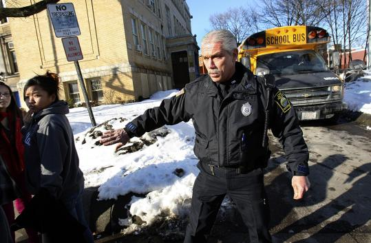 Because of budget cuts, Robert Ferrari is the only school resource officer remaining in Lynn. Hamstrung by the loss of local aid, the city has had to make a number of layoffs and cut its library budget.