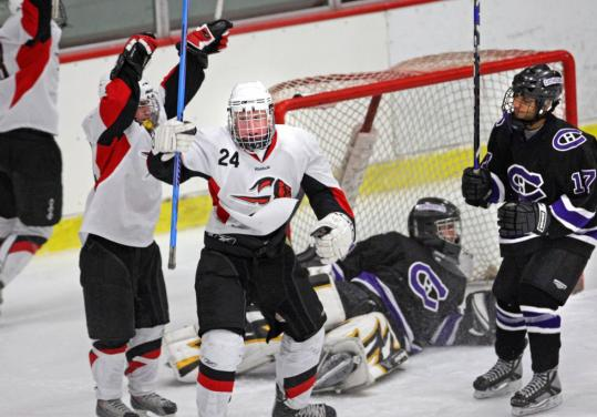 Winchester's T.J. Hickey (24) celebrates after beating Springfield Cathedral goalie Stefan Audet to give the Sachems a 1-0 lead in the first period.