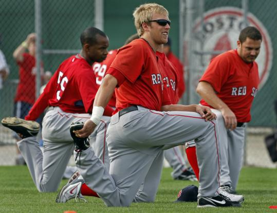 Lars Anderson loosens up during stretching; things can tighten up a bit when young players try to show other players, coaches, and management what they can do.