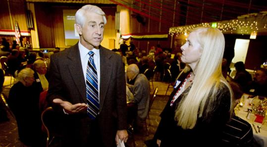 US Representative David G. Reichert talked with Jane Milhans at the Lincoln Day Breakfast last Saturday in Tacoma, Wash.