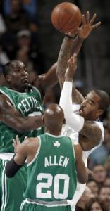Ray Allen has the best view in the house of Celtics center Kendrick Perkins's block of the Nuggets' J.R. Smith.