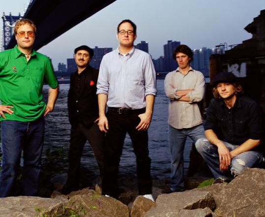 The Hold Steady (top) cover Springsteen on ''War Child Presents Heroes.'' Spoon plays on ''Dark Was The Night.''