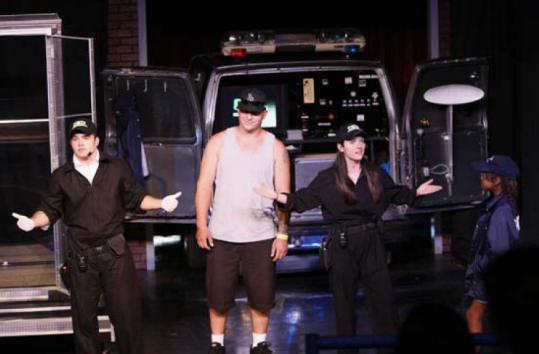 The cast of 'CSI: Live' invites audience members on stage.