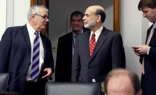 Fed chairman Ben Bernanke (right) testified at a House Financial Services Committee hearing chaired by Barney Frank.