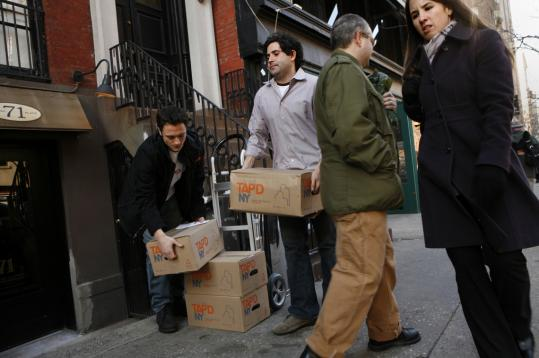Craig Zucker (center) and his business partner, Jon Flax, delivered cases of their product. One of their promotional stickers calls it ''the anti-bottled-water bottled water.''
