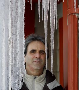 Author Dave Zeltserman, framed by icicles dripping from his Needham home, saw his novel ''Small Crimes'' singled out for praise last year.
