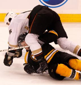 Anaheim's George Parros decks Phil Kessel in the third period.