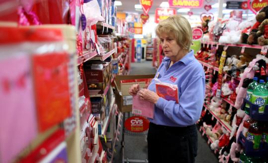 Jonathan Wiggs/Globe StaffKathy Palliola, 64, said she is ''too young to retire'' from her job at CVS in Spencer. Her husband, Mario, 70, works in the pharmacy.