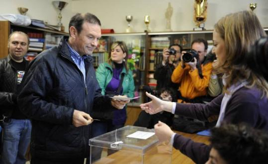 Basque premier Juan Jose Ibarretxe voted yesterday in regional elections. Non-nationalist parties won a majority.