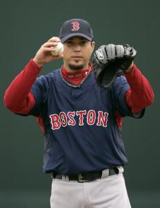 In a bit of a switch, it's Josh Beckett giving a sign to the catcher while warming up in the first.
