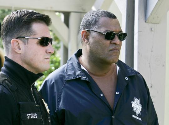 Laurence Fishburne (right, with George Eads) as new forensic investigator Ray Langston on ''CSI: Crime Scene Investigation.''