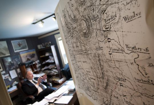In an office adorned with maps of a Vermont long past, Paul Gillies researches the lost roads that once crisscrossed the Green Mountain State. A law recently passed requires towns to find and document the roads or lose the right to them.