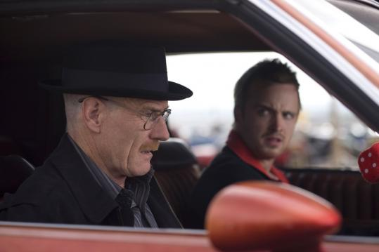 Bryan Cranston (top left, with Aaron Paul) plays Walter White, a dying man dealing meth to leave his family financially secure. Anna Gunn (below) plays White's pregnant wife.