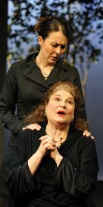 Rachael Warren (standing) and Anne Scurria give strong performances in David Hare's play.