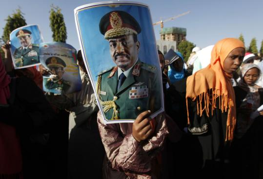 Demonstrators held up pictures of Omar al-Bashir during a rally in Khartoum protesting an International Criminal Court arrest warrant for the Sudanese president.
