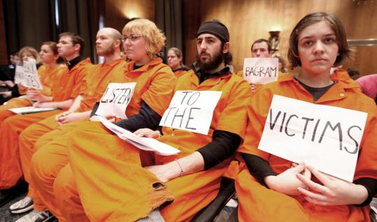 Protesters dressed in orange jumpsuits to evoke Guantanamo prison detainees attended the Senate Judiciary Committee hearing yesterday on the proposed ''truth commission'' to investigate the Bush administration's national security policies.