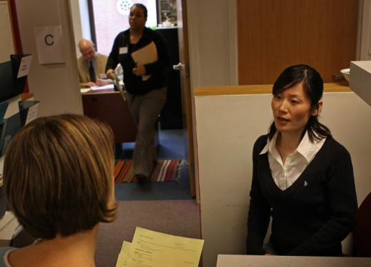 Xiu Ying Lu goes through her mock interview with Jenny Lisle, a volunteer, at the International Institute of Boston.