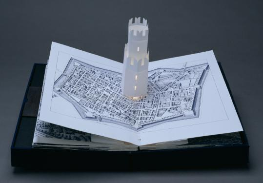 Carol June Barton's ''Five Luminous Towers: A Book to Be Read in the Dark,'' a pop-up book replete with light bulb.